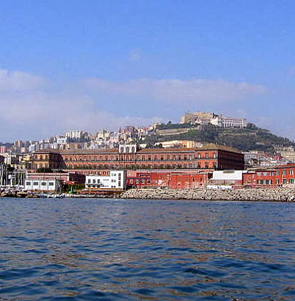 Royal Palace seen from the Sea with Castel Sant'Elmo in the distance.]